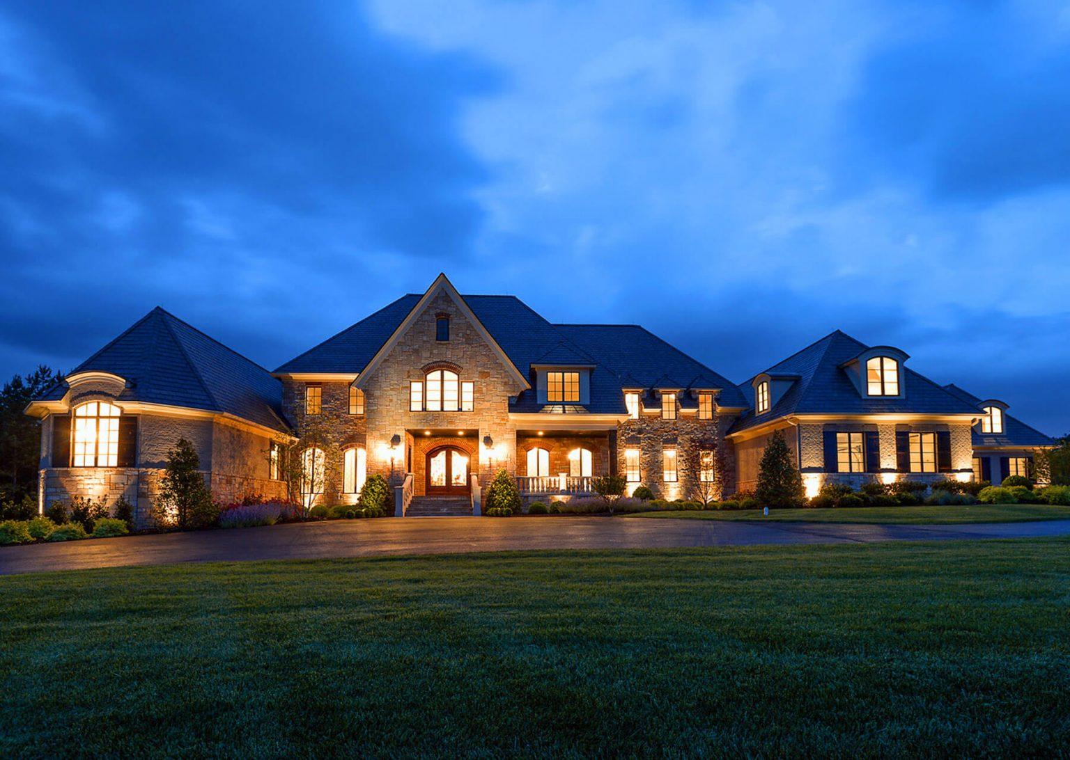 large villa home at dusk