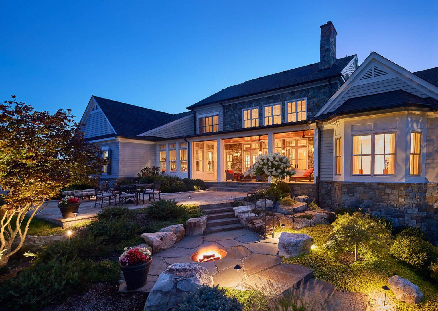 beautiful home with backyard patio with stonework